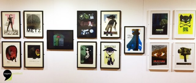 display of 14 cool merch posters in frames
